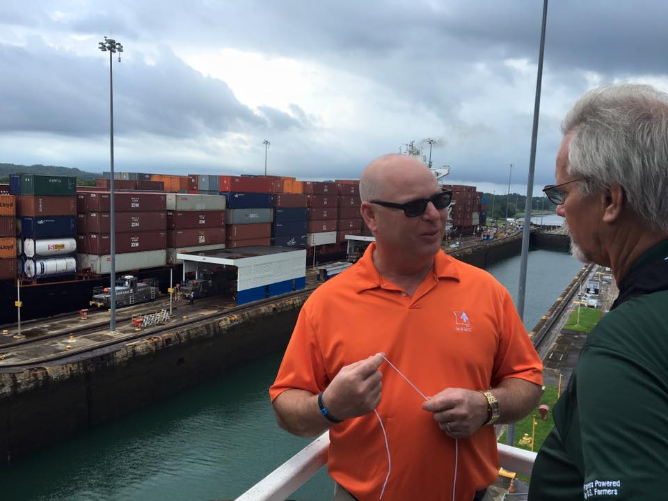 Missouri soybean farmer Tim Gottman discusses the Panama Canal as a fully-loaded Panamax ship enters the lock behind him.